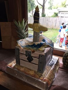 This is a pirate themed cake for my Godson's 9th birthday party. I really like how the chest and map came out but I would do a few things differently on the dagger. I was pleasantly surprised the way the gold-painted Oreos for the coins under the map came out.  Everything is edible minus the string inlay on the handle and the improvised cake stand.
