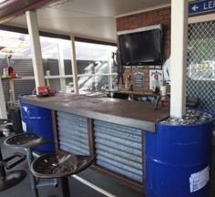 Front section of the Bar made from 44 gallon drums, with tractor seat stools. Kick rail S/steel. Designed and Built by John BuggerMe Designs. https://www.facebook.com/BuggerMeDesigns