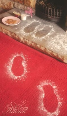 Santa footprints... Put a shoe down and sprinkle some flour and glitter around it