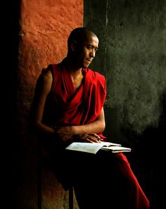 Buddhist monk reading and thinking in Thikesey Monastery in Leh, Ladakh.