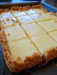 CREAMY LEMON SQUARES: FOR THE CRUST 4 tablespoons butter, melted and cooled, plus more for pan cup graham cracker crumbs ¼ cup sugar FOR THE FILLING 2 large egg yolks 1 can ounces) sweetened condensed milk ½ cup fresh lemon juice lemons) How 13 Desserts, Dessert Recipes, Lime Desserts, Paleo Dessert, Dessert Food, Party Desserts, Fruit Recipes, Dessert Ideas, Weight Watcher Desserts