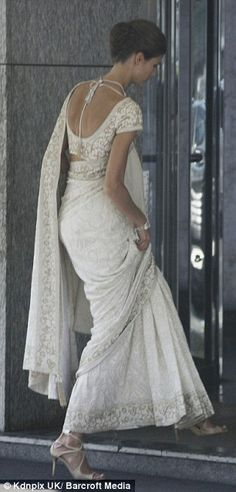 Kendra, 24, wears an ivory sari with intricate gold embroidery to marry Prince Rahim