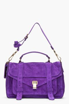 PROENZA SCHOULER-Veruca Salt Purple Suede foldover PS1 messenger bag-$1695 Supple suede messenger bag in royal purple.Tonal paneling throughout. Brass-tone hardware. Foldover flap at main compartment with belt details and hinged, logo-embossed clasp closure,adjustable leather shoulder strap with lobster claw clasps. Zippered welt pocket and patch pocket with magnetized press-stud closure under foldover flap.SEE DETAILS HERE: http://www.designerhandbagspurses.net/brief-cases-and-laptop-bags/