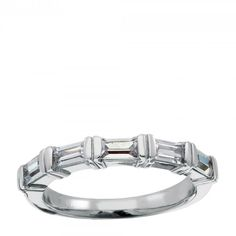 This sleek and modern semi-eternity band holds five straight baguettes end-to-end in bar  settings for a cool, understated look without sacrificing brilliance for  a light, sophisticated, easygoing design.    Available in a range of carat weights.  See menu above. Five Baguette cut Nexus Diamond Simulants Order additional services like a personal engraving or an appraisal for $25 each.  Contact customer service for details at 1.800.509.4990. Shown in 14k gold; call customer service for an…