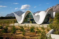 The Sculptural Design Of This Chapel Emulates The Mountains That Surround It British architecture firm Steyn Studio have recently completed the Bosjes Chapel located within the Bosjes Farm vineyard in Western Cape nbsp hellip Sacred Architecture, Architecture Cool, British Architecture, Cabinet D Architecture, Religious Architecture, Contemporary Architecture, Colonial Architecture, Architecture Religieuse, Glazed Walls