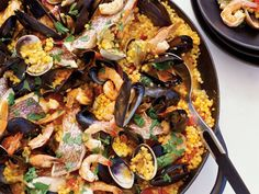 Sardinian-Style Paella | Fregola, the pearl-size Sardinian pasta that is quite similar to couscous, makes a terrific substitute for rice in this paella-style dish; it soaks up...