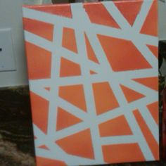 Easy art - masking tape, spray paint, and a canvas.
