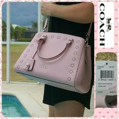 """**LAST DAY**  NEW Coach Margot satchel If not sold by today, it goes back for a refund!  FINAL price.  Margot satchel / crossbody in petal pink.  Leather with border stud accents & silver-toned hardware.  Pink fabric lining with 3 slip pockets.   Middle divider compartment has zip closure & main closure is magnetic.  Handles have 4"""" drop.  Size: 14""""L x 9""""H x 6""""W.  Style#F36640.  Removable hanging key fob.   Removable & adjustable crossbody/shoulder strap.   New with tags & box.   Accordian…"""
