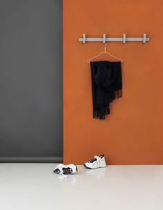 Hoop is a modern coat rack by Normann Copenhagen that elegantly adds color and practicality to your hallway wall. Shop the coat rack online here.
