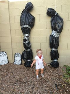Zombie toddler and hanging corpses