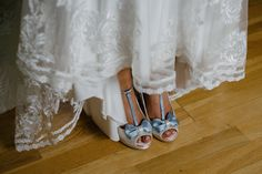 Add a little something blue to your wedding by designing your own shoes. Photo by www.judebrownephotography.com.