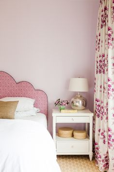 Katie Ridder fabric | Caitlin Moran Interiors - Custom headboard upholstered in Raoul fabric, bedside tables by Bungalow 5, drapery in Katie Ridder print, lamps by Pottery Barn, carpet by Stark.