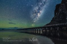 Tolaga Bay Milky Way. - Pinned by Mak Khalaf Tolaga Bay Milky Way. Has been a while since I have been out and shot some astro so why not kill the time with a bit of Photoshop. I shot this image of Tolaga Bay Gisborne with the Moon Rising. I chose to drop the Milky Way in instead as the lighting from the moon the details in the pier etc provided quite a good challenge. I hope you like this creation :) Fine Art Popular Tagsastronomyastrophotographyastroscapebeachcompositegalaxygisbornelong…