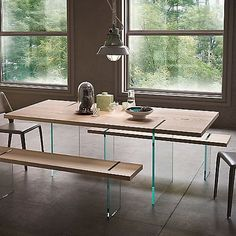 $2500 A unique look you will not be able to find anywhere else. The Modloft Firenze Dining Table has a floating appearance with its 2 glass legs. Each leg is perpendicular to the ground and flush-mounted on a textured Italian wood veneer top. A distinctly modern touch is placed on each side of Firenze with its legs cutting through the wood tabletop. If you are looking for a statement piece for your dining room or kitchen, you have found it. Seats 8 guests.
