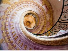 Melk Abbey Staircase, Melk, Austria    You may recognize this mazelike Benedictine abbey overlooking the Danube River as inspiration for Umberto Eco's popular novel The Name of the Rose. It's full of architectural flourishes like this Rococo-style spiral staircase—best viewed from underneath to catch a glimpse of the pink-and-gold painted underside. While the staircase leads to other rooms of the library, they aren't open to the public.