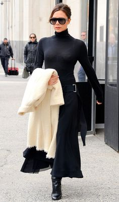 fbe2e18cf2 Victoria Beckham in a black turtleneck dress Classy Fall Outfits