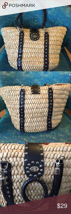 """Huge Hand Woven Corn Tote, Zingara So much more than just a beach bag!  This tote is rockin'!  Zingara beachwear bag, woven from corn husks. Straps & exterior details are probably not leather, but they do look like leather. Removable straps are 27"""" long. All the faux leather in great condition. There is some minor staining in the lining & the stitching is loose around the top of the bag in one spot. Both the biggest stain & the stitching issues are pictured together. This bag has been used…"""