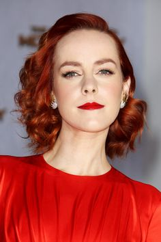 """""""Once I saw her hair done, and she put the dress on, I knew the look called for a red, ombré lip,"""" says Streicher. She combined E.L.F. Studio lipsticks in Red Carpet and Velvet Rope for the perfect shade."""