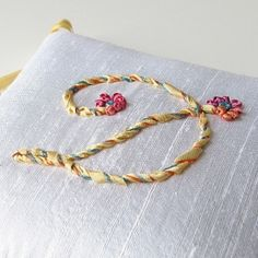 I don't usually go in for monograms, but this one in silk ribbon embroidery is unexpectedly pleasing by ava