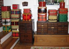 Using a collection of Vintage Picnic Baskets made of tin. Great craft room storage.