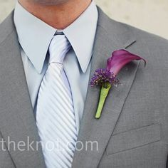 Gray suit with purple flower