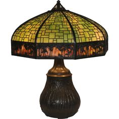 Antique Handel Sunset Palm Border Overlay Lamp with Handsome Handel Swampy Base The lamp shade contains 9 green glass panels under an irregular brick mold pattern and 9 sunset panels painted with palm. Brick Molding, Antique Lighting, Oil Lamps, Craftsman Style, Cool Lighting, Light Shades, Glass Panels, Overlays, Palm