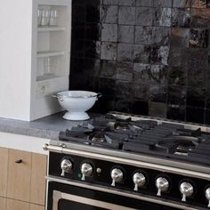 zelliges wall tiles, bluestone counters and oak cabinetry