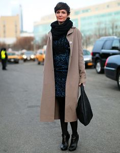 Harper's Bazaar Street Style  A classic, taupe coat looks great with everything. Here, on Net-a-Porter head of PR Tenley Zinke, it's paired with a printed dress with a bit of evening flair and works perfectly.