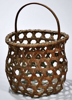 Skinner's - The Personal Collection of Lewis Scranton, Auction 2897M. May 21, 2016. Lot: 345.  Estimate: $500-700.  Realized: $1,600.   Description:  Woven Splint Cheese Weave Clam Basket, America, 19th century, ht. 16 in.
