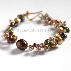 Going for Baroque! Strung-Out guitar string bracelet with freshwater pearls by strungoutstars on Etsy