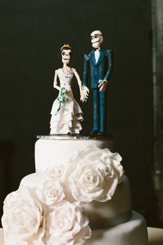 Dia de los Muertos cake topper, photo by Lad & Lass Photography http://ruffledblog.com/turbine-hall-wedding #caketoppers #dayofthedead