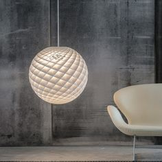 This natural focal point and ball-shaped pendant floats like a majestic focal point in the room, spreading light in all directions. Its detailed design features a host of circles, angles and holes.