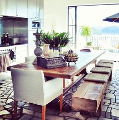 Indoor outdoor kitchen, gorgeous floor tile, wood table, fabric head chair, rustic wood bench with cushions Dining Area, Kitchen Dining, Dining Room, Kitchen Wood, Open Kitchen, Dining Chairs, Dining Table, Rustic Wood Bench, Wood Benches