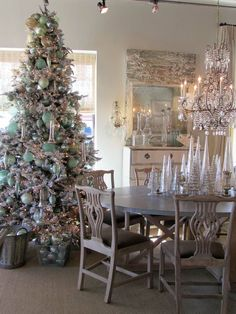 Pale blue Christmas ornaments, silver glass trees, amazing chandelier--Vintage Living - Lisa Luby Ryan