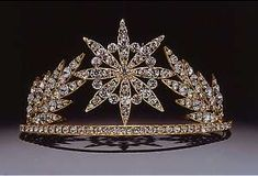 "Elton John Tiara. Cartier created this rhinestone tiara for Elton John for his now annual ""White Tie & Tiara Ball"". In 2011 the party raised 5 million pounds for his AIDS foundation. This tiara was included in the Victoria and Albert Museum tiara exhibition in 2002."