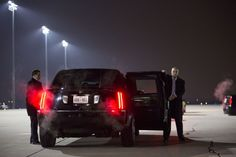 Last Days on the Road with Obama by Brooks Kraft ... Secret Service agents hold the doors to President Obama's limousine as he arrives in Des Moines, IA.  Nov. 5, 2012 - LightBox