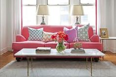 Cute! And cute colors! console table behind sofa in front of window