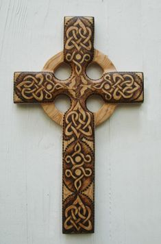 Love and Peace Celtic Christian Cross-Stylized Celtic Heart-Wood burned carving. $168.00, via Etsy.