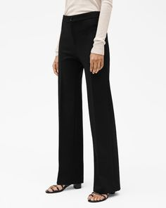 Tailored trousers with a high waist and flared, full length shape. A flattering essential with mindful details, such as Corozo nut front button. Wear with a smart jacket or an effortless T-shirt. Tailored Trousers, Slacks, Smart Shorts, Smart Jackets, How To Stretch Boots, Black Pants, Casual, How To Wear, Shirts