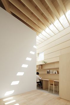 Light Walls House by mA-style architects skylights positioned around the roof to bring in natural light