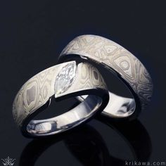 This wedding ring set features our Mokume Wave Engagement Ring with a Marquise Cut Diamond and a matching Winter Mokume Wedding Band for him, both with palladium liners. Design your ring set in the metals, mokumes and stones you both love!