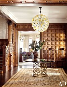 The wood-paneled formal entry of a Boston townhouse designed by Thad Hayes.