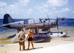 OS2U Kingfisher at the edge of the seaplane ramp at NAS Pensacola, Florida, United States, early 1941. Note Consolidated P2Y flying boat laying off shore