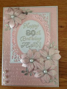 Pink card with stamped flowers