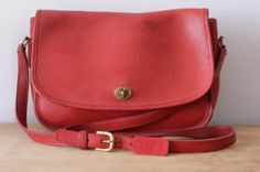 Vintage Coach bag in a coral-y red.
