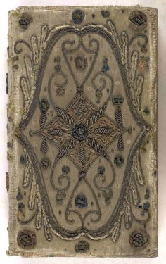 Beaded and embroidered book cover on velvet.  Beauty lies in its craftsmanship, not in its perfection....