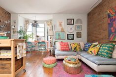 Apartment Therapy's News and Culture Editor Lives in a Bold 'Boho Rainbow Brite' Boston Home: gallery image 11 Boston Apartment, Rainbow Brite, H&m Home, Upholstered Sofa, Small Rugs, Colorful Furniture, Rental Apartments, House Colors, Apartment Therapy