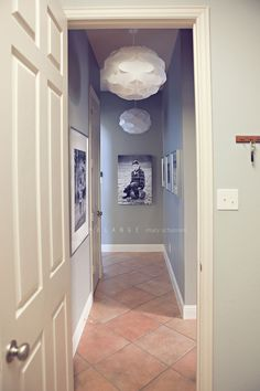 photo hallway idea. 7 Mary Schannen. Love the colour and the lampshades.