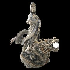 Kuan Yin (Goddess of Compassion) riding Dragon holding Pearl Beyond Price
