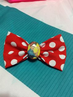 Hand made hair bow red w/ white polka dots and a resin Rosie the riveter center
